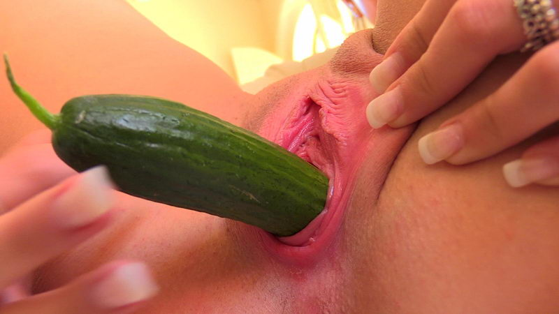 Two Cucumbers in Vagina of a Teen